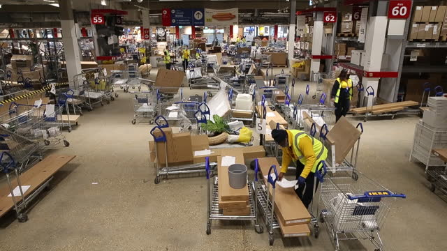 ikea employees prepare 'click and collect' orders at the ikea store in croydon, u.k., on tuesday, nov. 17, 2020. ikea saw a 45% surge in its online... - employee stock videos & royalty-free footage