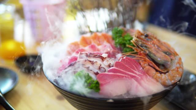 ikizukuri sashimi with dry ice at japanese restaurant. - dry ice stock videos & royalty-free footage
