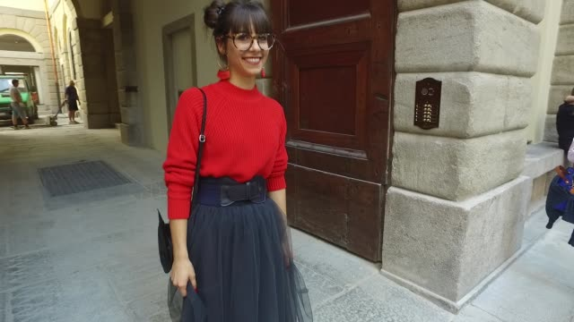 Ilaria Miotto wearing a HM pullover and bag a Dani skirt vintage shoes and Ralph Laureen sunglases on September 24 2016 in Milan Italy