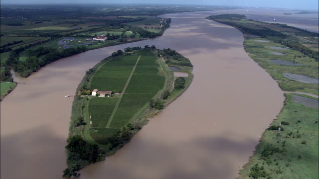 ile de la tour de mons - aerial view - aquitaine, gironde, france - aquitaine stock videos and b-roll footage