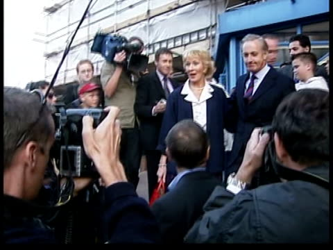 vídeos de stock, filmes e b-roll de ilford: barking police station: ext christine hamilton and husband former conservative minister neil hamilton along to car after being questioned by... - ilford