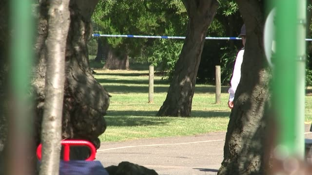 vídeos de stock, filmes e b-roll de teenager charged with attempted murder; england: ilford: loxford park: ext police officer on duty in cordoned-off road outside loxford park police... - ilford