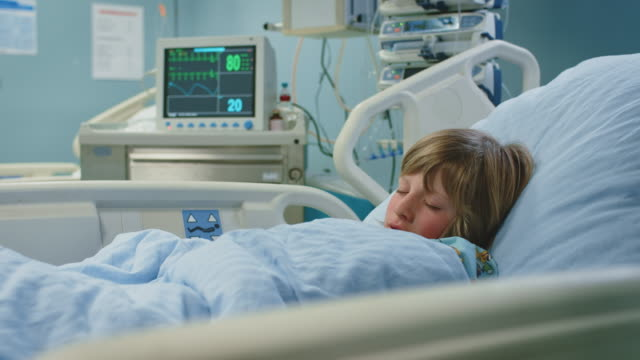 ill boy sleeping on bed in emergency room - hospital ward stock videos & royalty-free footage