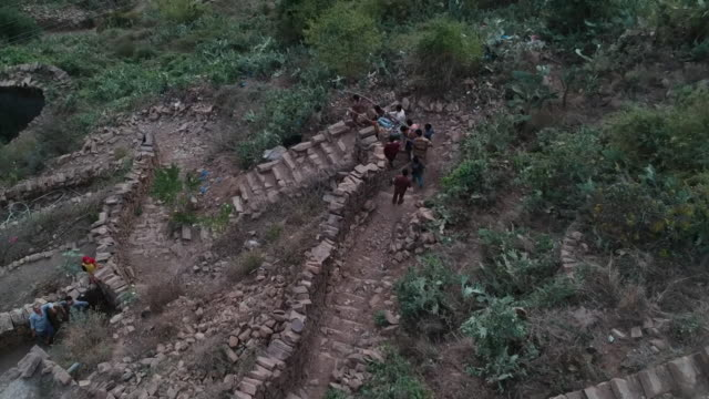 ill villager being carried on stretcher down mountain to local clinic in raymah a remote village in yemen - remote location stock videos & royalty-free footage