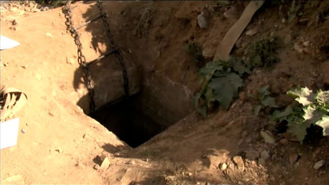 illegal gold miners reluctant to be rescued from mine shaft south africa benoni ext hole in ground - mine shaft stock videos and b-roll footage