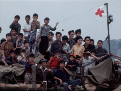 Illegal immigrants arrive on junk boats from China HONG KONG EXT Crowded junk ship listing in water GV Junk ships sailing close to harbour area...