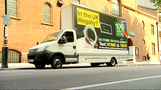 campaign to persuade them to leave gvs van with trailer poster england london ext general views of white van with trailer poster for the home office... - trailer home stock videos & royalty-free footage