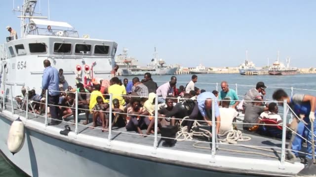 Illegal migrants from Africa arrive at a naval base in Tripoli after being rescued in the Mediterranean Sea off the Libyan coast