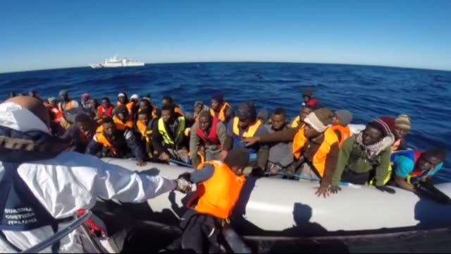 illegal migrants have been reported rescued by the vessels and three cargo ships of the italian coast guard on wednesday march 4, 2015 off the south... - 2015 stock-videos und b-roll-filmmaterial