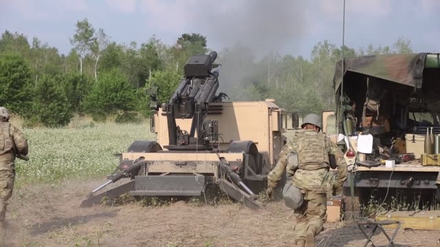 illinois army national guard conduct a live fire exercise with the hawkeye 105mm howitzer mobile weapon system at camp grayling, michigan as part of... - howitzer stock videos & royalty-free footage