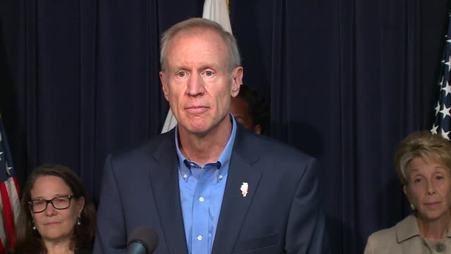 wgn illinois gov bruce rauner signed legislation on sept 28 allowing state health insurance and medicaid coverage for abortions ending months of... - medicaid stock videos and b-roll footage