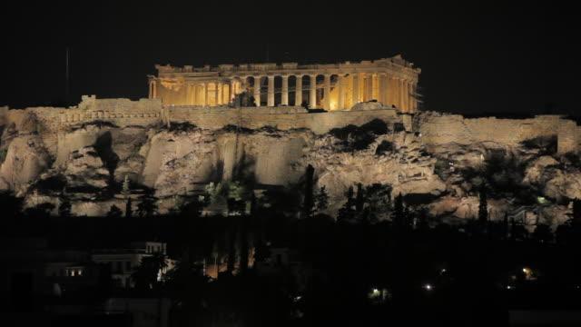 ms illuminated acropolis & parthenon at night / athens, greece - acropolis athens stock videos & royalty-free footage
