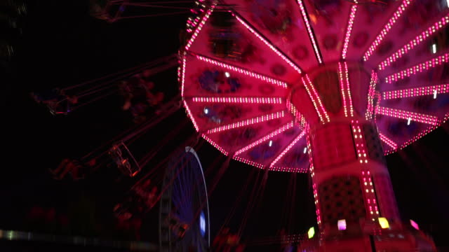 Illuminated amusement park ride, Hong Kong,
