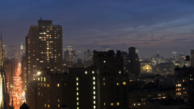 T/L, MS, Illuminated apartment buildings in Greenwich Village, dusk to night, New York City, New York, USA