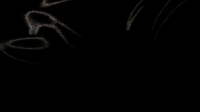 vídeos de stock, filmes e b-roll de cetim preto iluminado - squiggle