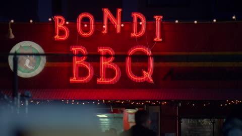 ms illuminated 'bondi bbq' restaurant sign / venice, california, usa - capital letter stock videos & royalty-free footage