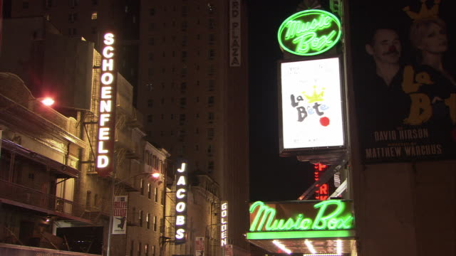 ms illuminated broadway marquees at buildings on 45th street, theatre district at night, music box theater in foreground playing 'la bete' starring david hyde pierce / manhattan, new york city, new york, usa - theatre banner commercial sign stock videos & royalty-free footage