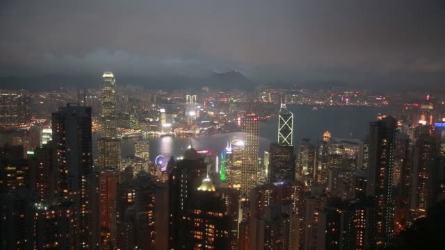 illuminated buildings are seen from victoria peak at dusk in hong kong china on friday jan 22 2016 - victoria peak stock videos & royalty-free footage