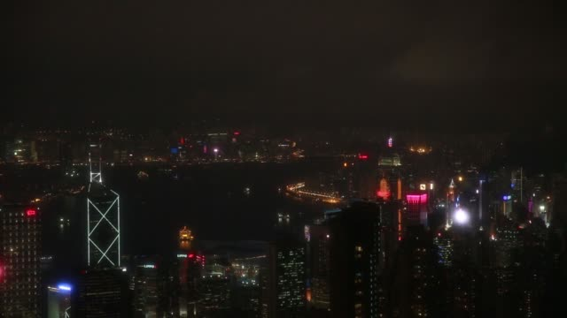 stockvideo's en b-roll-footage met illuminated buildings are seen from victoria peak at night in hong kong china on friday jan 22 2016 - victoria peak