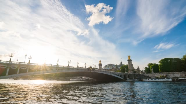 illuminated by the sun, arch bridge pont alexandre iii over seine river in paris - river seine stock videos & royalty-free footage
