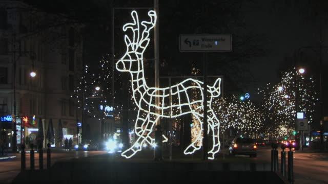 WS, Illuminated Christmas reindeer at night, Kurfuerstendamm, Berlin, Germany