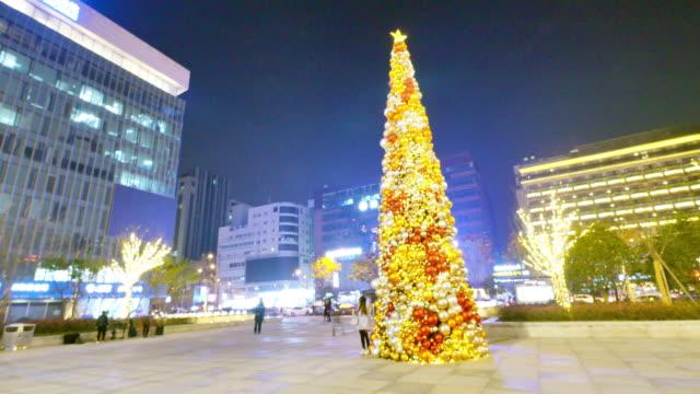 illuminated Christmas Tree on square at night