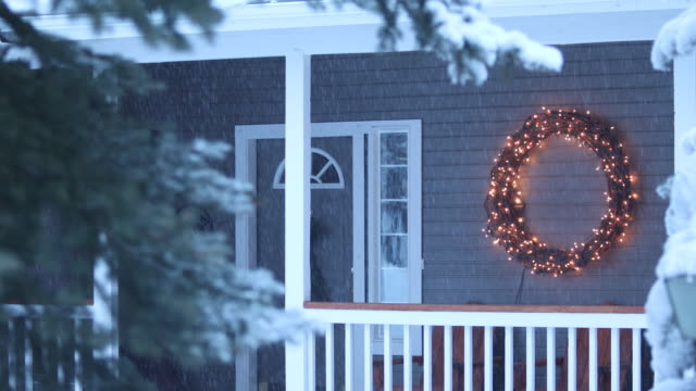 illuminated christmas wreath on house - wreath stock videos & royalty-free footage