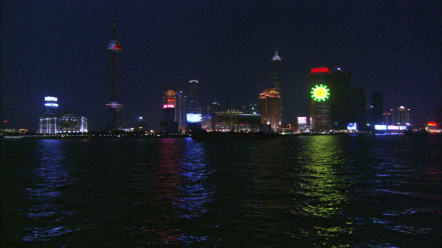 la ws illuminated city skyline with oriental pearl tower and jin mao tower along waterfront at night / shanghai, china - jin mao tower stock videos & royalty-free footage
