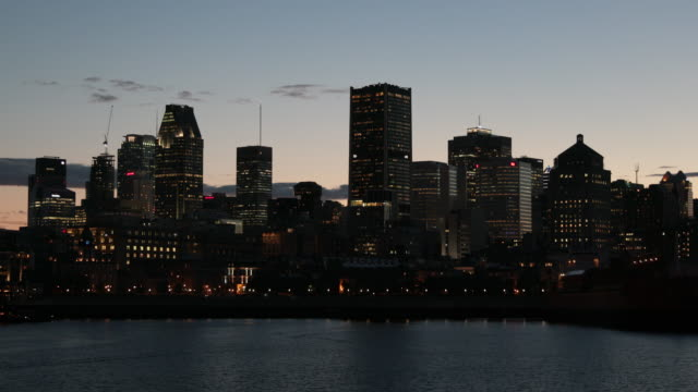 illuminated cityscape of montreal, quebec at dusk - montreal stock videos & royalty-free footage