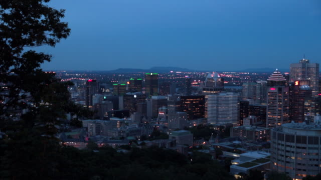 illuminated cityscape of montreal, quebec at dusk - vieux montréal stock videos & royalty-free footage