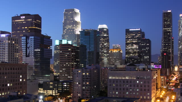T/L WS PAN Illuminated downtown skyscrapers, dusk to night / Los Angeles, California, USA