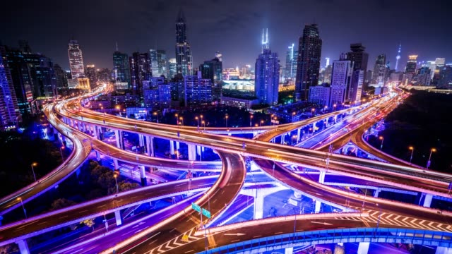 t/l ws ha illuminated elevated roads and busy traffic at night / shanghai, china - esposizione lunga video stock e b–roll