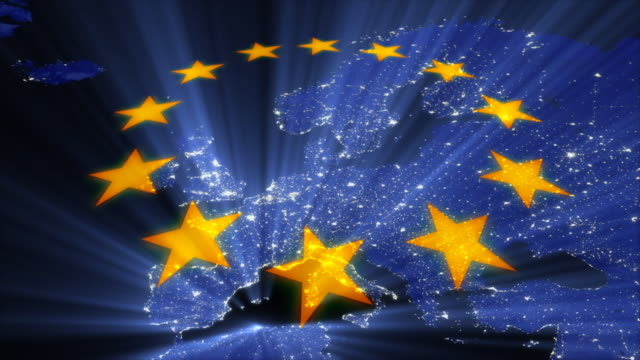 CGI, Illuminated Europe seen from space, European Union stars spinning in foreground