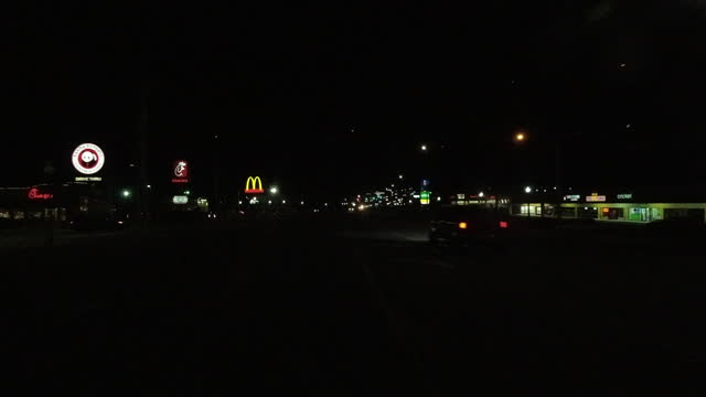 illuminated fast food signs at night in the suburb of atlanta amid the covid-19 pandemic in atlanta, georgia on april 7, 2021. - speed stock videos & royalty-free footage
