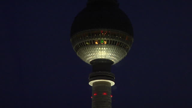 cu, illuminated fernsehturm television tower against sky at night, berlin, germany - alexanderplatz stock videos & royalty-free footage