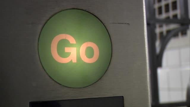 ECU Illuminated 'Go' sign lighting on stored-value card reader / New York, New York, USA