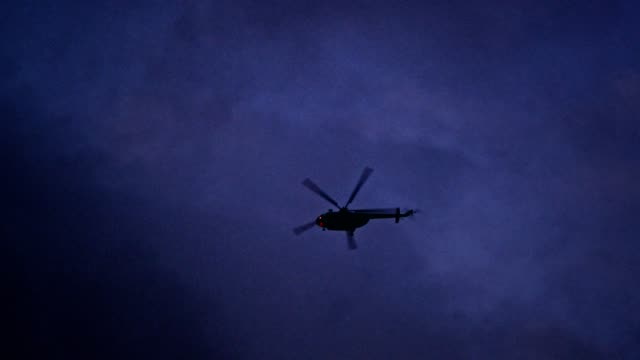illuminated helicopter flying above city in the night - police force stock videos and b-roll footage