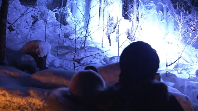 illuminated icefall and tourists, aomori, japan - icefall stock videos and b-roll footage