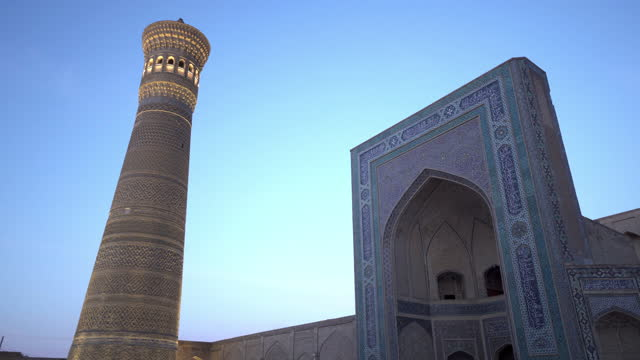 illuminated kalan mosque against clear sky - bukhara, uzbekistan - minaret stock videos & royalty-free footage