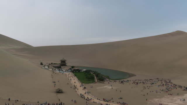 illuminated lake in desert / dunhuang, gansu - desert oasis stock videos & royalty-free footage