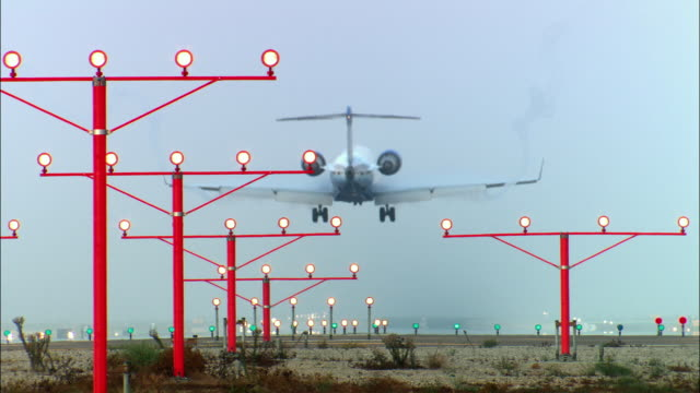 Ms Illuminated Landing Lights And Airplane Landing On Runway Rear