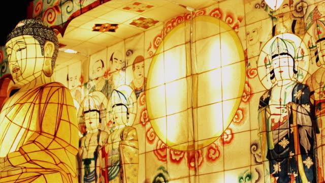 ms pan illuminated large paper lanterns at buddha's day lantern parade, night, seoul, south korea - buddha's birthday stock videos and b-roll footage