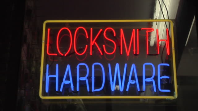 "cu, tu, illuminated ""locksmith hardware"" neon at night, new york city, new york, usa - shop sign stock videos & royalty-free footage"