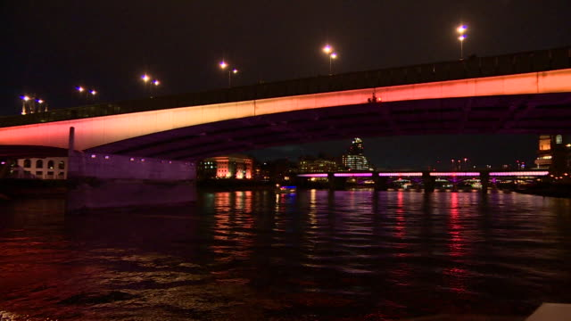 illuminated london bridge - river thames stock videos & royalty-free footage