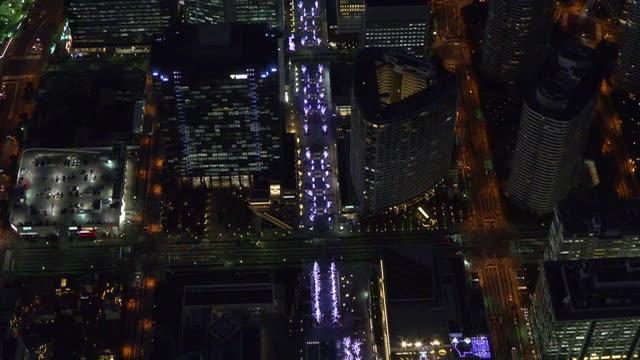 aerial, illuminated minatomirai at dusk, yokohama, japan - tokyo bay stock videos & royalty-free footage