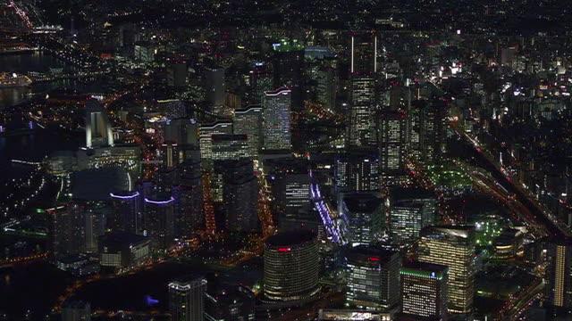 aerial, illuminated minatomirai at dusk, yokohama, japan - hotel stock videos & royalty-free footage