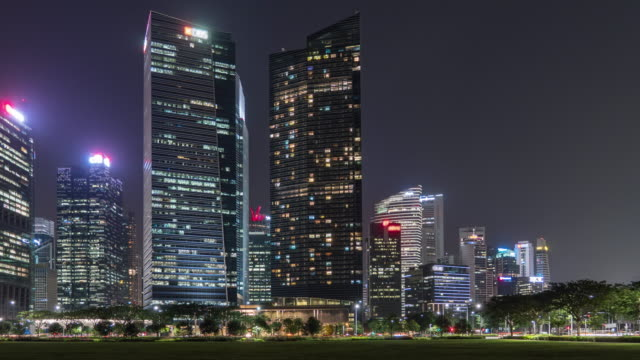 illuminated modern buildings at night, singapore, time lapse video - directly below stock videos & royalty-free footage