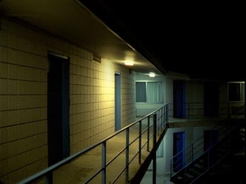 MS, Illuminated motel balcony at night, Tonopah, Nevada, USA