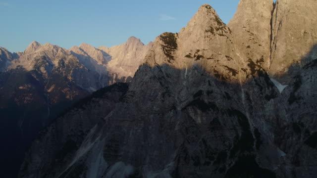illuminated mountain peaks with sunlight during sunset - slovenia stock videos & royalty-free footage