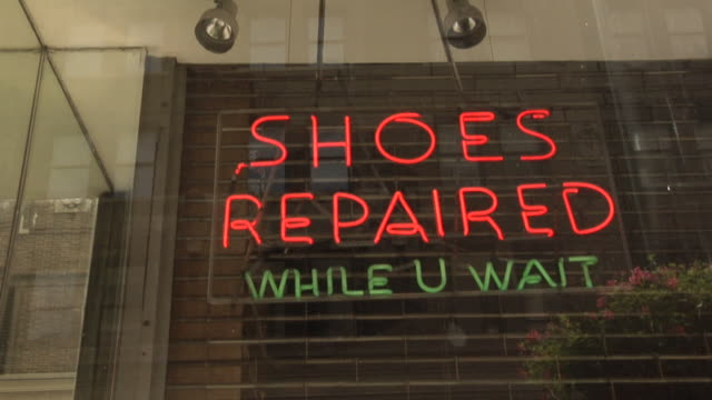 cu, td, la, illuminated neon at shoe repair shop, new york city, new york, usa - ladenschild stock-videos und b-roll-filmmaterial